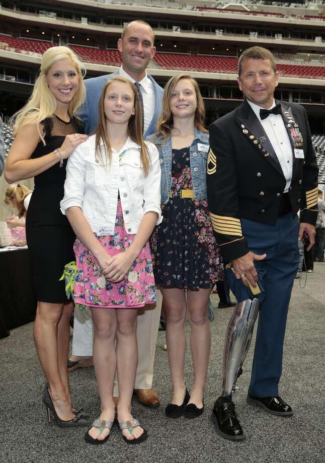Laurie and Matt Schaub, left, Tyler Bowman, Sydney Bowman and Sgt. Dana Bowman Photo: Larry Pullen