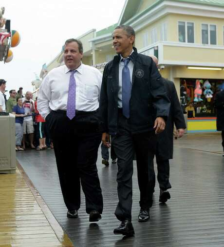 President Barack Obama and New Jersey Gov. Chris Christie walk along the boardwalk during their visit to Point Pleasant, N.J., to view the Jersey Shore's recovery efforts from Hurricane Sandy. Photo: Pablo Martinez Monsivais, STF / AP