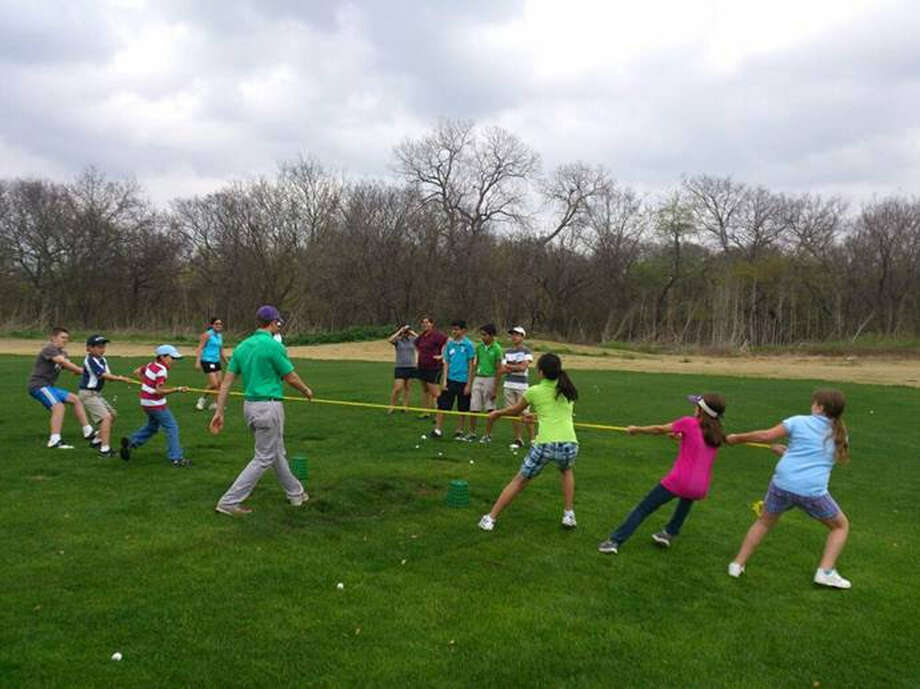 Campers with The First Tee of San Antonio, competing in a tug of war, learn more than just fundamental golf skills. Photo: Courtesy Photo / The First Tee Of San Antonio