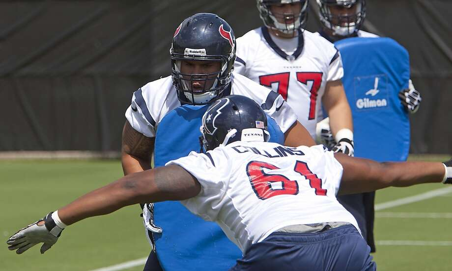 Brandon Brooks, left, and Bryan Collins work during a drill.