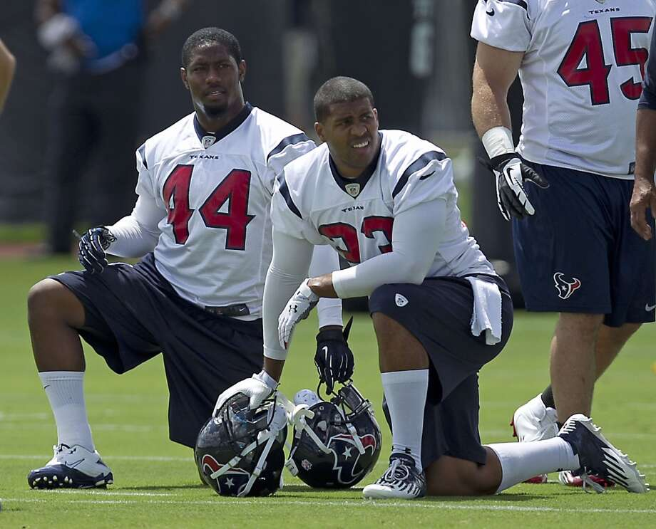 Ben Tate, left, and Arian Foster take a knee during Tuesday's workout.