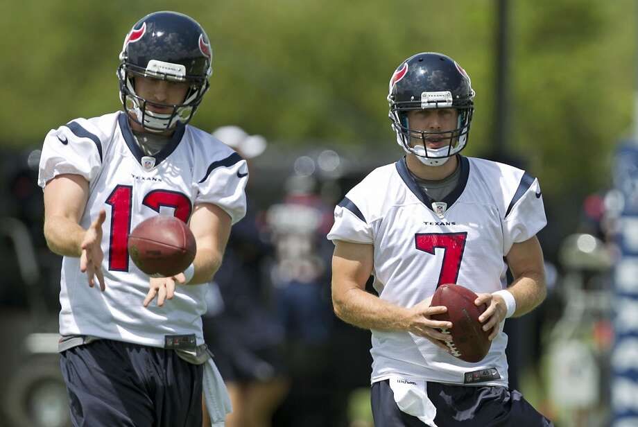 Backup QBs T.J. Yates, left, and Case Keenum work on their ball skills.