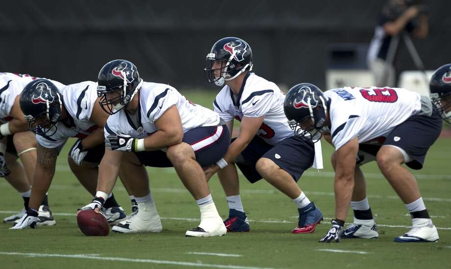 Texans quarterback T.J. Yates, second from right, prepares for the snap.