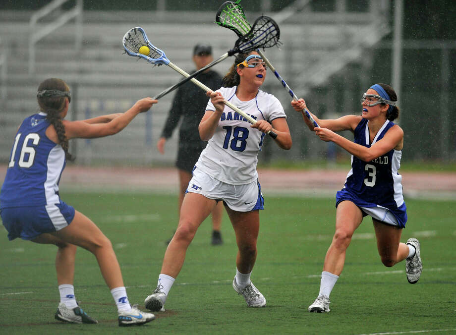 Darien's Jena Fritts shoots and scores during the first round Division L state playoff game against Fairfield Ludlowe at Darien High School on Tuesday, May 28, 2013. Darien won, 21-2. Photo: Jason Rearick / Stamford Advocate