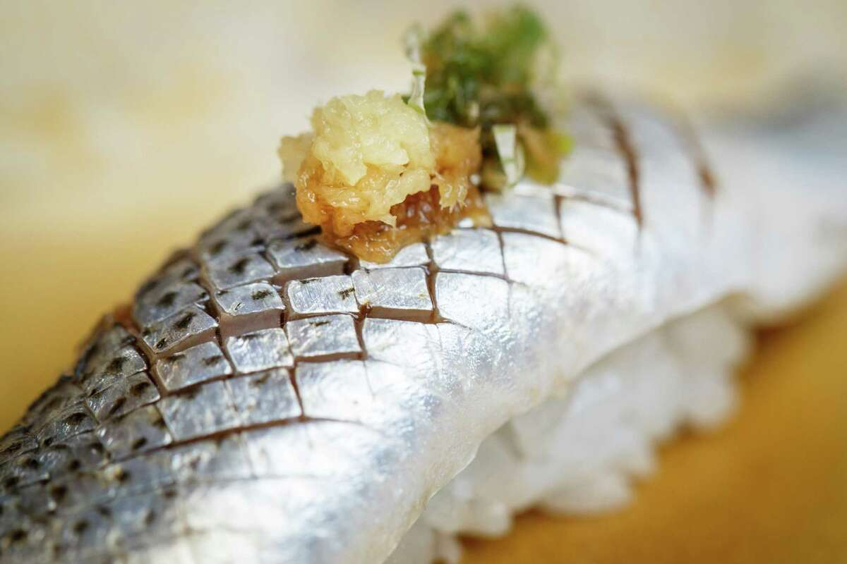 Kohada, a gizzard shad served with fresh grated ginger and green onions, looks like an exotic mosaic.