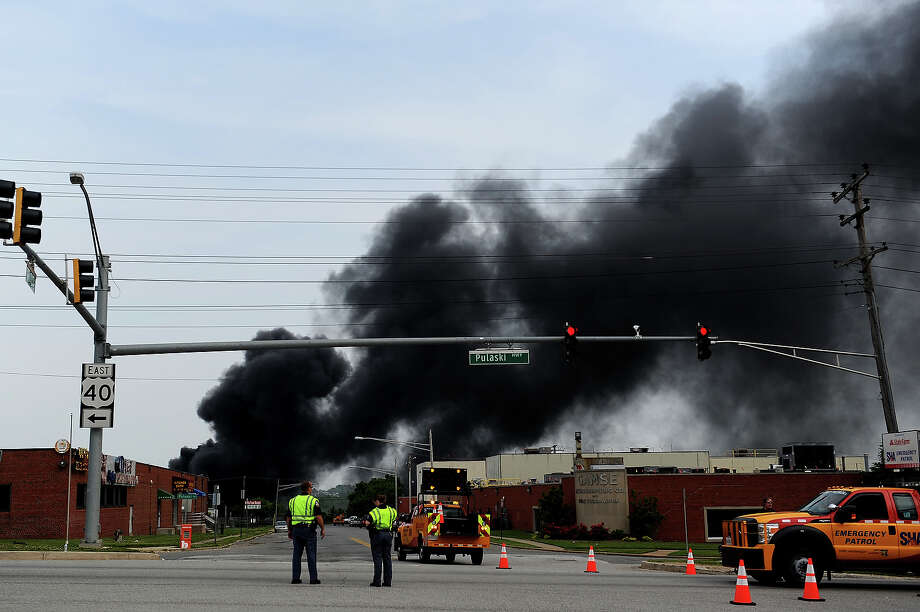 Smoke billows from a train derailment that caused a major explosion in the Rosedale neighborhood on May 28, 2013 in Baltimore, Maryland. Residents in nearby neighborhoods were advised to voluntarily evacuate. Photo: Patrick Smith, Getty Images / 2013 Getty Images