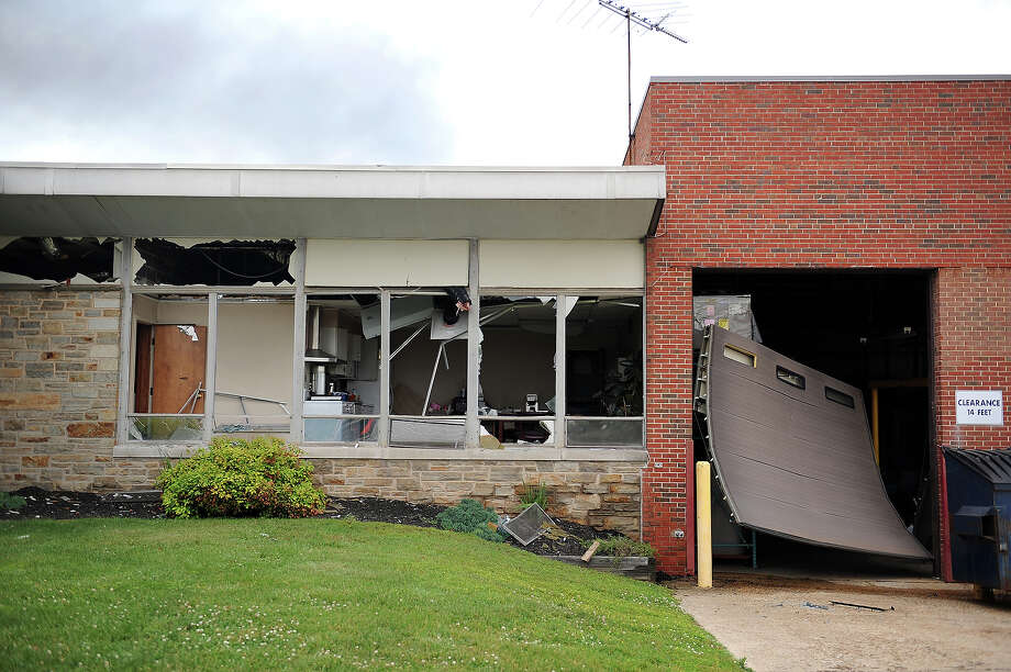 Windows and a garage door of a nearby business are blown out from a train derailment that caused a major explosion in the Rosedale neighborhood on May 28, 2013 in Baltimore, Maryland. Residents in nearby neighborhoods were advised to voluntarily evacuate. Photo: Patrick Smith, Getty Images / 2013 Getty Images