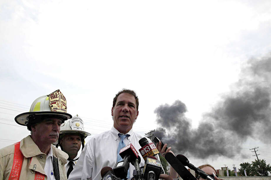 Baltimore County Executive Kevin Kamentz stands with Baltimore County Fire Chief John J. Hohman, left, and Assistant Fire Chief Jeffrey Segal as he speaks to reporters about the White Marsh train derailment in Rosedale, Md., Tuesday, May 28, 2013. Photo: Charles Dharapak, AP / AP