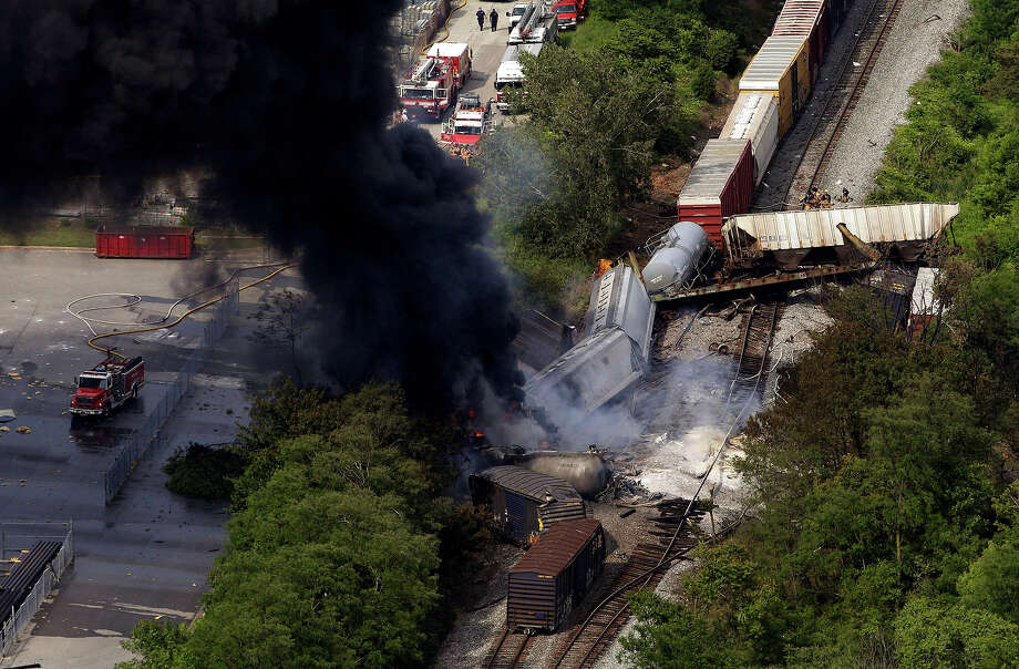 A fire burns at the site of a CSX freight train derailment, Tuesday, May 28, 2013, in White Marsh, Md., where fire officials say the train crashed into a trash truck, causing an explosion that rattled homes at least a half-mile away and collapsed nearby buildings, setting them on fire. Photo: Patrick Semansky, AP / AP