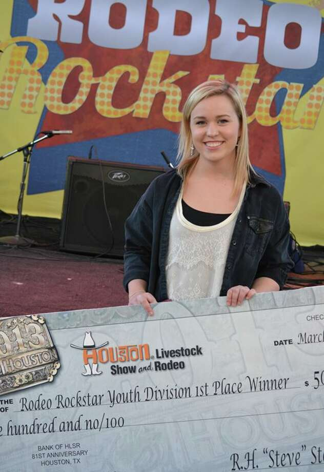 Tori McClure with her Rodeo Rockstar competition prize check. Photo: RodeoHouston