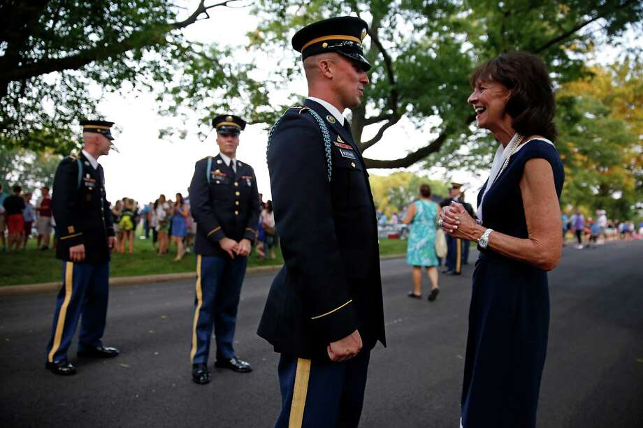 Stamford resident Deborah A. Tymon, the senior vice president of marketing for the New York Yankees, chats with a soldier last week, when she received the U.S. Army's Outstanding Civilian Service Award. Photo: New York Yankees