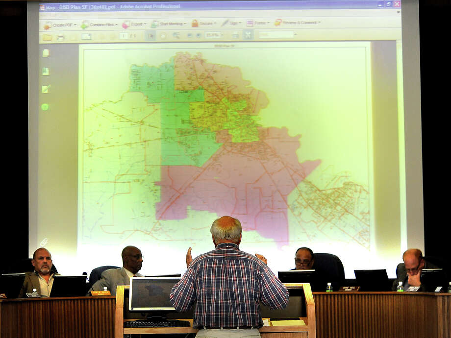 Dr. Tom Sanders presents the revised resdistricting map presented to the board during the meeting at the BISD Administration Building in Beaumont, Thursday,  April 19, 2012. Tammy McKinley/The Enterprise Photo: TAMMY MCKINLEY