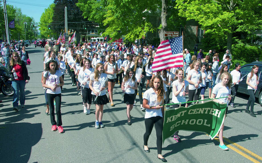 The Kent Center School band marches proudly north from the monument during the Kent Memorial Day parade. May 27, 2013 Photo: Trish Haldin