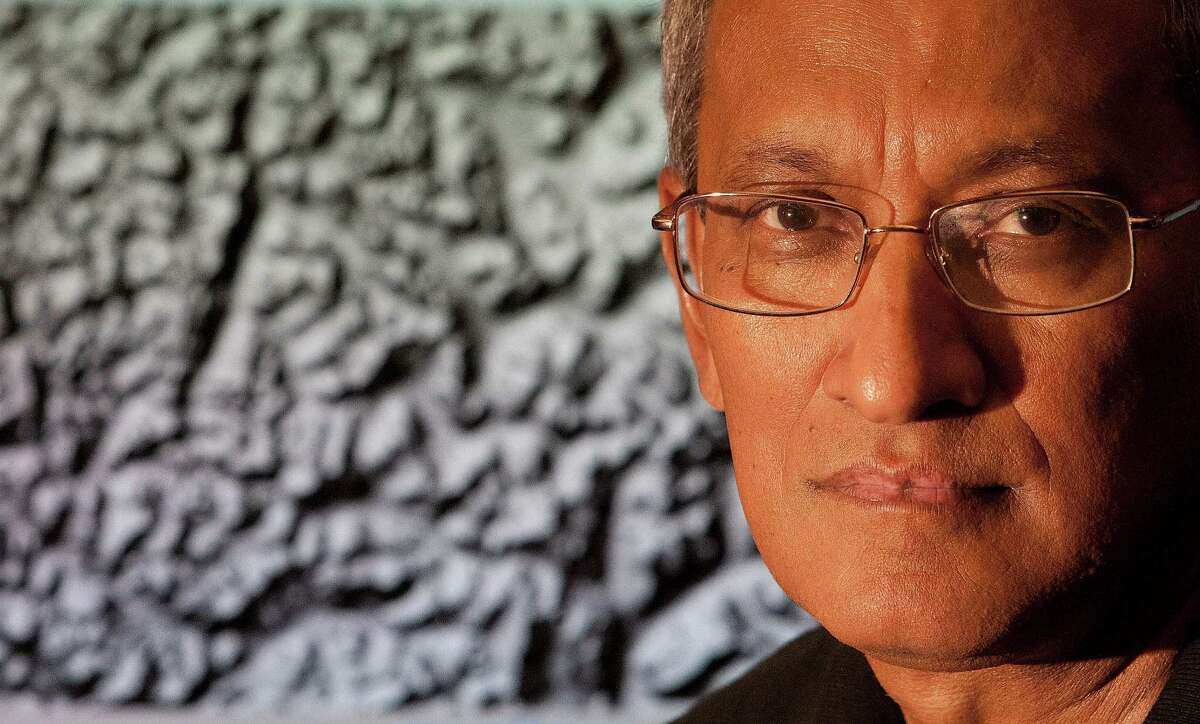 Ramesh Shrestha is a UH professor and director of the National Center for Airborne Laser Mapping. Behind him is a recent pulsed-laser image of a rain forest in Honduras.