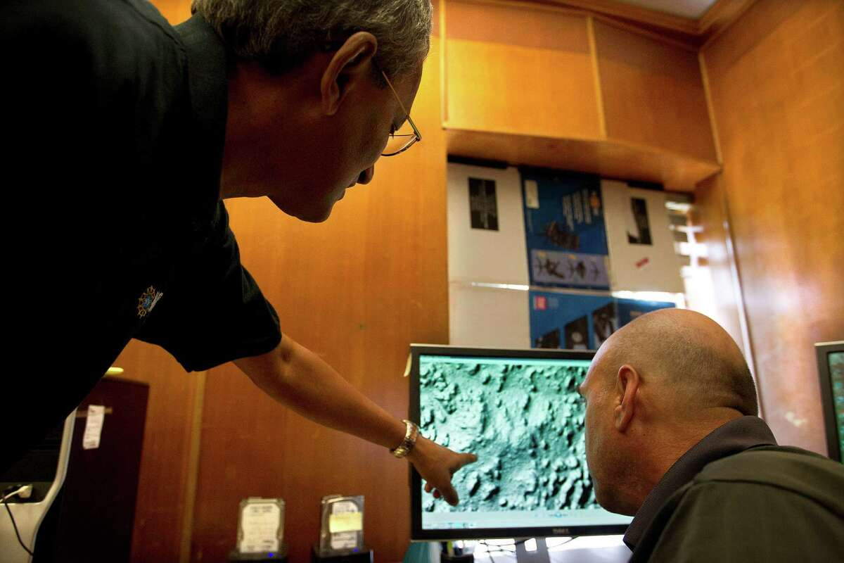 Ramesh Shresthy director of the National Center for Airborne Laser Mapping at the University of Houston looks with staff researcher Michael Sartori at recent imaging from Honduras of seen through the imaging provided by LiDAR (Light Detection and Ranging) technology that gives an accurate account of the typography of an area Thursday, May 23, 2013, in Houston. LiDAR uses a remote sensing method from an airplane pulsing light 100,000 points a second to give measurements of the Earth. ( Johnny Hanson / Houston Chronicle )