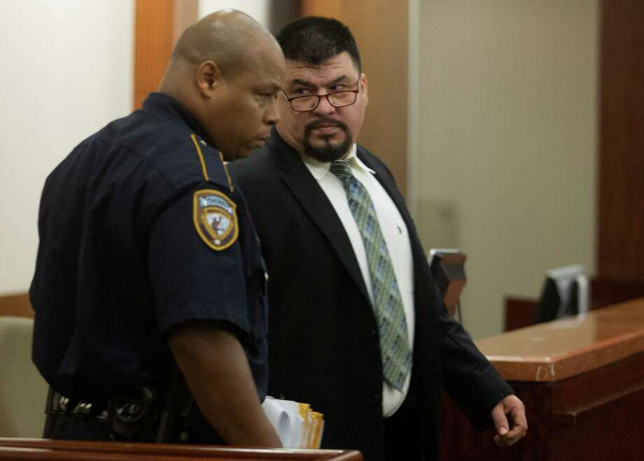 "Jorge Amezquita entered the courtroom Tuesday in Houston, only to learn that the jury picked to decide his fate would have to be replaced after one juror admitted he had gone online to learn about ""capital murder."" Photo: J. Patric Schneider, Freelance / © 2013 Houston Chronicle"