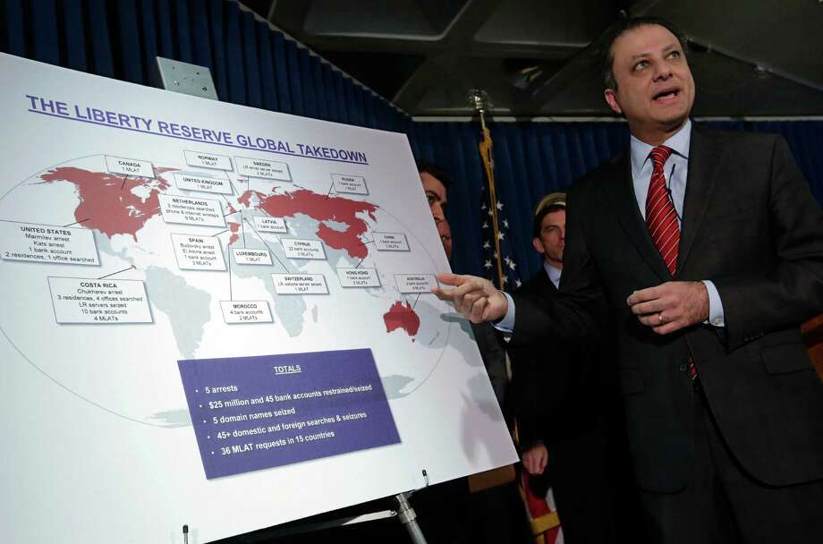 Preet Bharara, U.S. Attorney for the Southern District of New York,  describes a chart showing the global interests of Liberty Reserve, which  officials say engaged in a $6 billion money-laundering scheme that was  'staggering' in its scope. Photo: Richard Drew / Associated Press