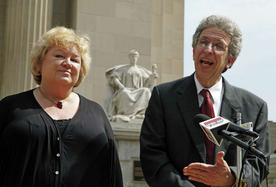 Betty Cockrum (left), president of Planned Parenthood of Indiana, and attorney Ken Faulk speak to reporters in this file photo. Indiana will likely stop defending a law that stripped Medicaid funds from Planned Parenthood after the Supreme Court declined to hear the case Tuesday. Photo: Michael Conroy / Associated Press