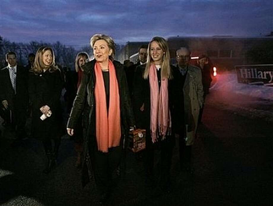 Democratic Presidential hopeful, Sen. Hillary Rodham Clinton, D-N.Y. carries a box of coffee as she and daughter, Chelsea, second from left, visit a polling place on primary day in Manchester, N.H., Tuesday, Jan. 8, 2008. Photo: Elise Amendola, AP / AP