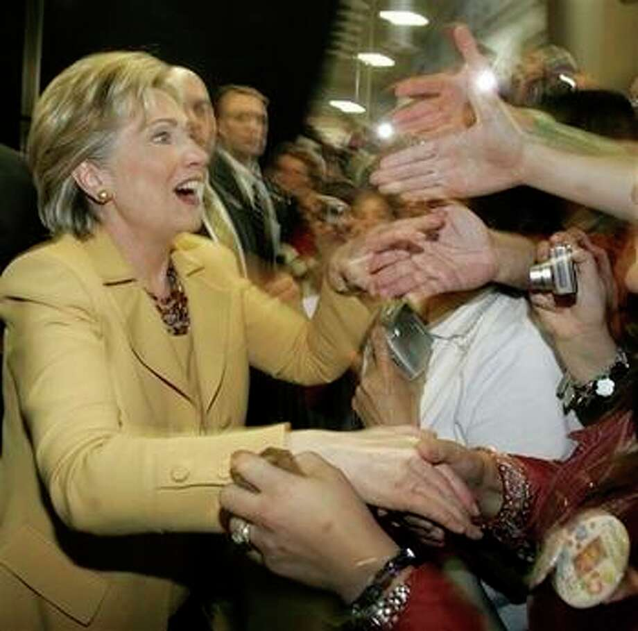 Democratic presidential hopeful, Sen. Hillary Rodham Clinton, D-N.Y., greets supporters as she makes a campaign stop at the Richard M. Borchard Regional Fairgrounds in Robstown, Texas, Wednesday, Feb. 13, 2008. Photo: Carolyn Kaster, AP / AP