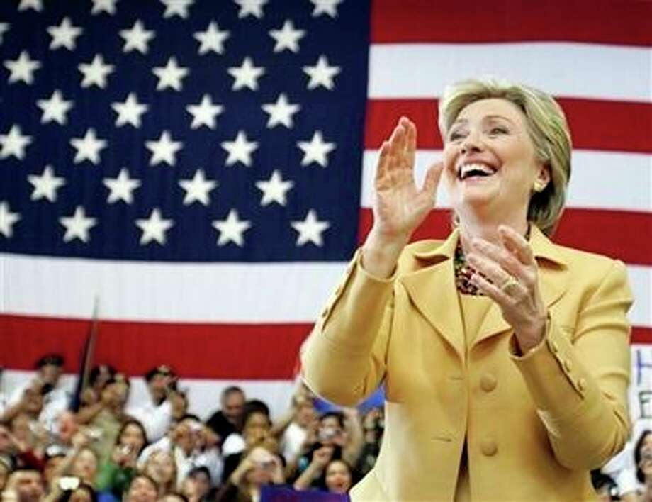 Democratic presidential hopeful ,Sen. Hillary Rodham Clinton, D-N.Y., applauds during a campaign stop at the Richard M. Borchard Regional Fairgrounds in Robstown, Texas, Wednesday, Feb. 13, 2008. Photo: Carolyn Kaster, AP / AP