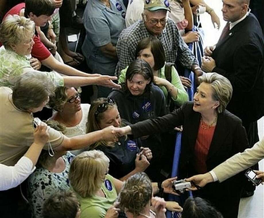 Democratic presidential hopeful Sen. Hillary Rodham Clinton, D-N.Y., shakes hands at a campaign event in Yankton, S.D., Monday, June 2, 2008. Photo: Elise Amendola, AP / AP