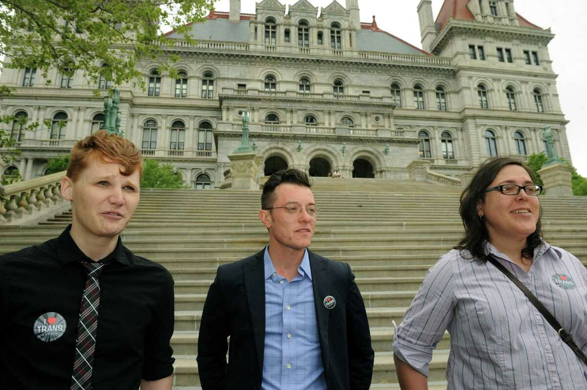 Transgender activists Drew Cordes, left, Christopher Argyros, center, and Paola Gonzalez on the front steps of the Capitol on Tuesday May 28, 2013 in Albany, N.Y. They are leading the fight to pass this legislative session the Gender Expression Non-Discrimination Act(GENDA). (Michael P. Farrell/Times Union)