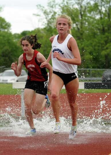 Saratoga's Keelin Hollowood, right, and Guilderland's Emily Burns run neck and neck in the girl's 20