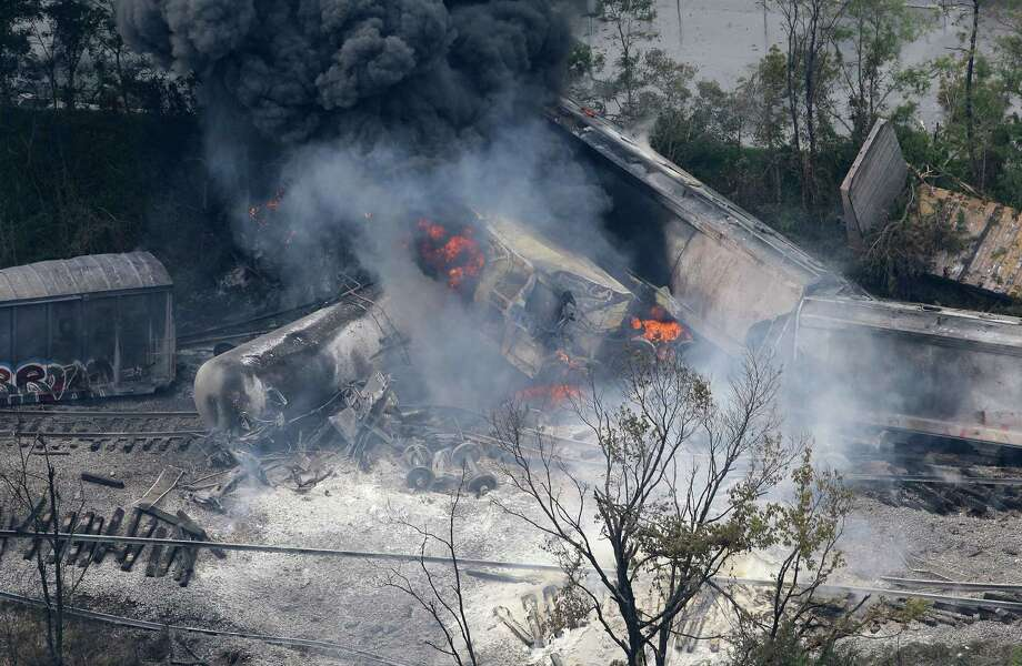 A fire burns at the site of a CSX freight train derailment, Tuesday, May 28, 2013, in Rosedale, Md., where fire officials say the train crashed into a trash truck, causing an explosion that rattled homes at least a half-mile away and collapsed nearby buildings, setting them on fire. (AP Photo/Patrick Semansky) Photo: Patrick Semansky