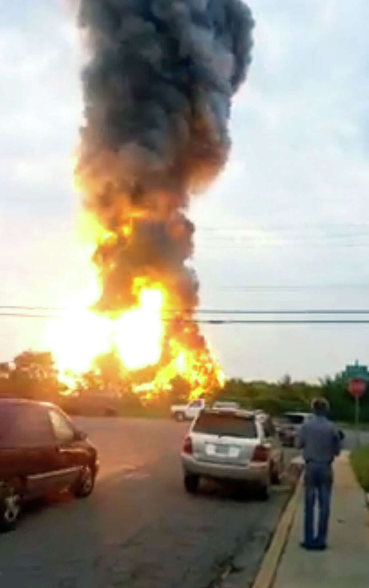 This still taken from video provided by James LeBrun shows an explosion outside Baltimore on Tuesday, May, 28, 2013. Baltimore County fire officials say a train derailed in a Baltimore suburb on Tuesday and an explosion was heard in the area. A fire spokeswoman says the train derailed about 2 p.m. Tuesday in White Marsh, Md. (AP Photo/James LeBrun)