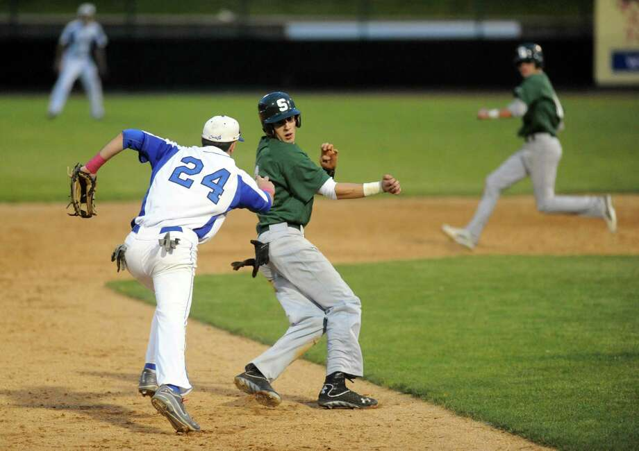 LaSalle's Dom Razzano tags Shen's John Novenche out as he goes to third during their Section 2 high school AA semifinals game on Tuesday May 28, 2013 in Troy, N.Y. (Michael P. Farrell/Times Union) Photo: Michael P. Farrell