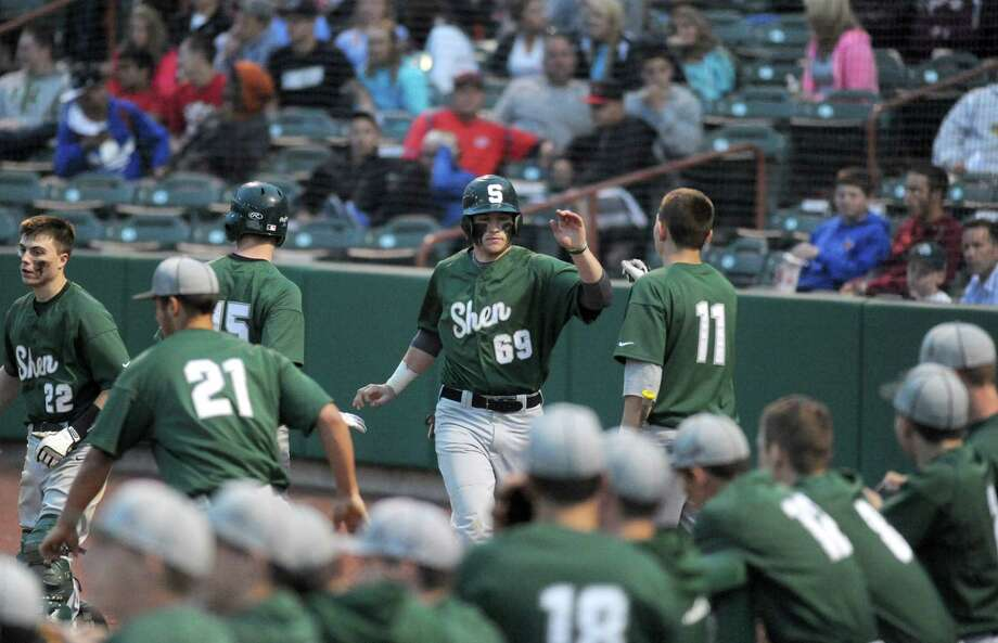 Shen's Chris Miller is congratulated by teammates after scoring during their Section II high school AA semifinals game against LaSalle on Tuesday May 28, 2013 in Troy, N.Y. (Michael P. Farrell/Times Union) Photo: Michael P. Farrell