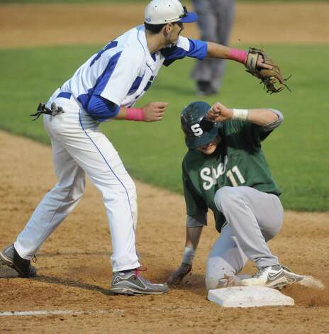 Shen's Brennan McCormack slides into third under the tag of LaSalle's Dom Razzano during their Section II high school AA semifinals game on Tuesday May 28, 2013 in Troy, N.Y. (Michael P. Farrell/Times Union) Photo: Michael P. Farrell