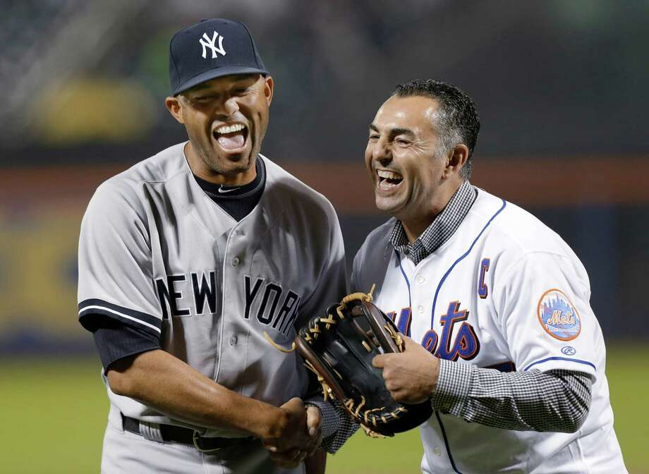 New York Yankees relief pitcher Mariano Rivera, left, laughs with former New York Mets closer John Franco after Franco caught Rivera's ceremonial first pitch before an interleague baseball game at Citi Field in New York, Tuesday, May 28, 2013. Photo: Kathy Willens