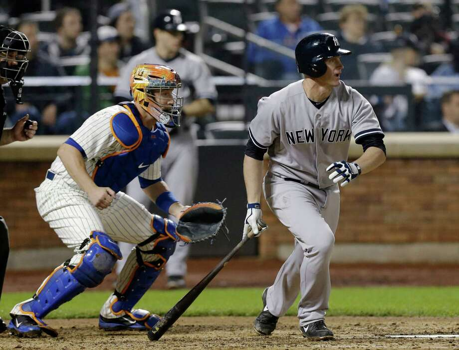 New York Yankees' Lyle Overbay, right, watches his sixth-inning RBI single off New York Mets starting pitcher Matt Harvey in an interleague baseball game at Citi Field in New York, Tuesday, May 28, 2013. Brett Gardner scored for the first run of the game. Photo: Kathy Willens