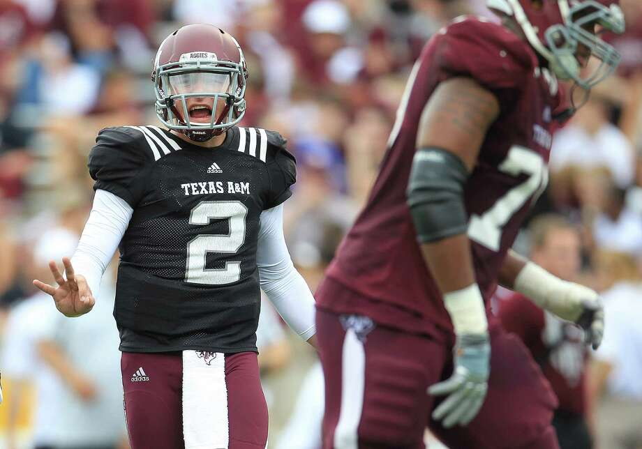 Texas A&M Aggies quarterback Johnny Manziel (2) between plays during the first half of the Texas A&M University's Maroon & White, spring game at Kyle Field, Saturday, April 13, 2013, in College Station.   ( Karen Warren / Houston Chronicle ) Photo: Houston Chronicle / © 2013 Houston Chronicle