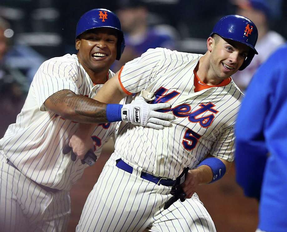 David Wright, right, and teammate Marlon Byrd were all smiles after saving their best for last in the Mets' walk-off win over the Yankees. Photo: Elsa, Staff / 2013 Getty Images