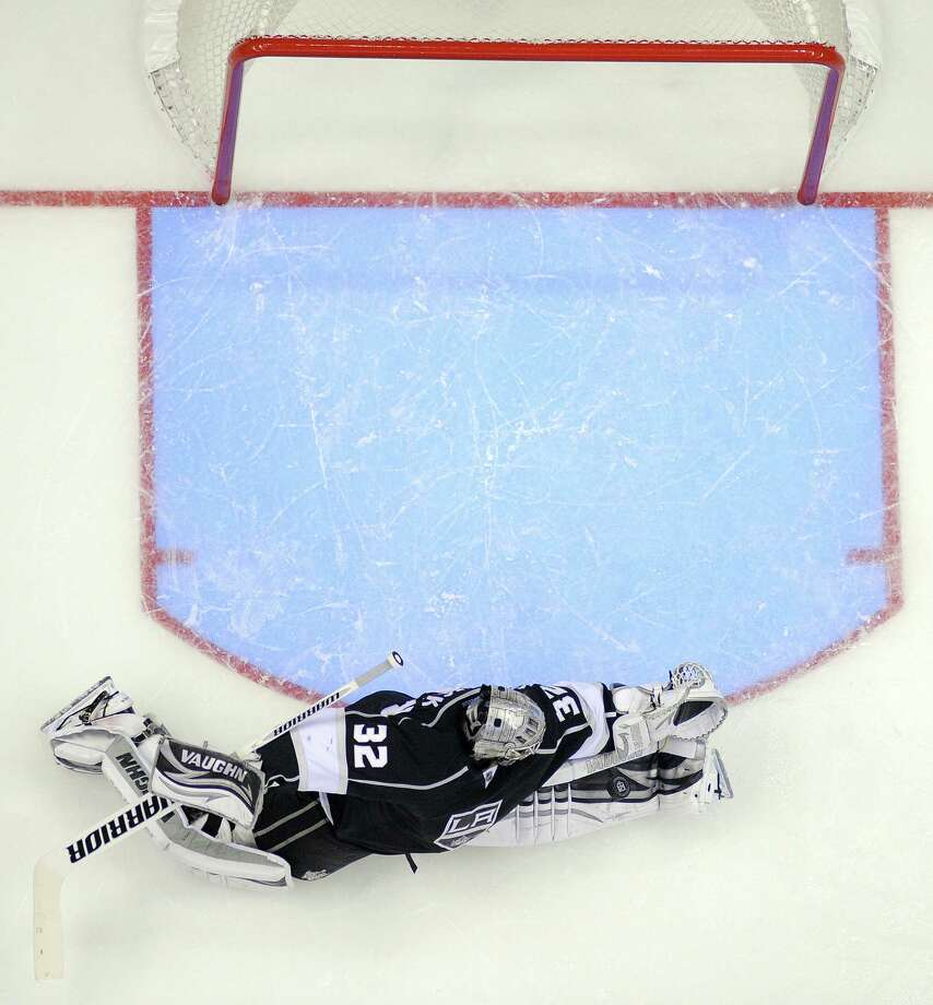 Kings goalie Jonathan Quick spreads out to make a save in the second period of Tuesday's Game 7 victory over the Sharks in Los Angeles. Photo: Mark J. Terrill / Associated Press