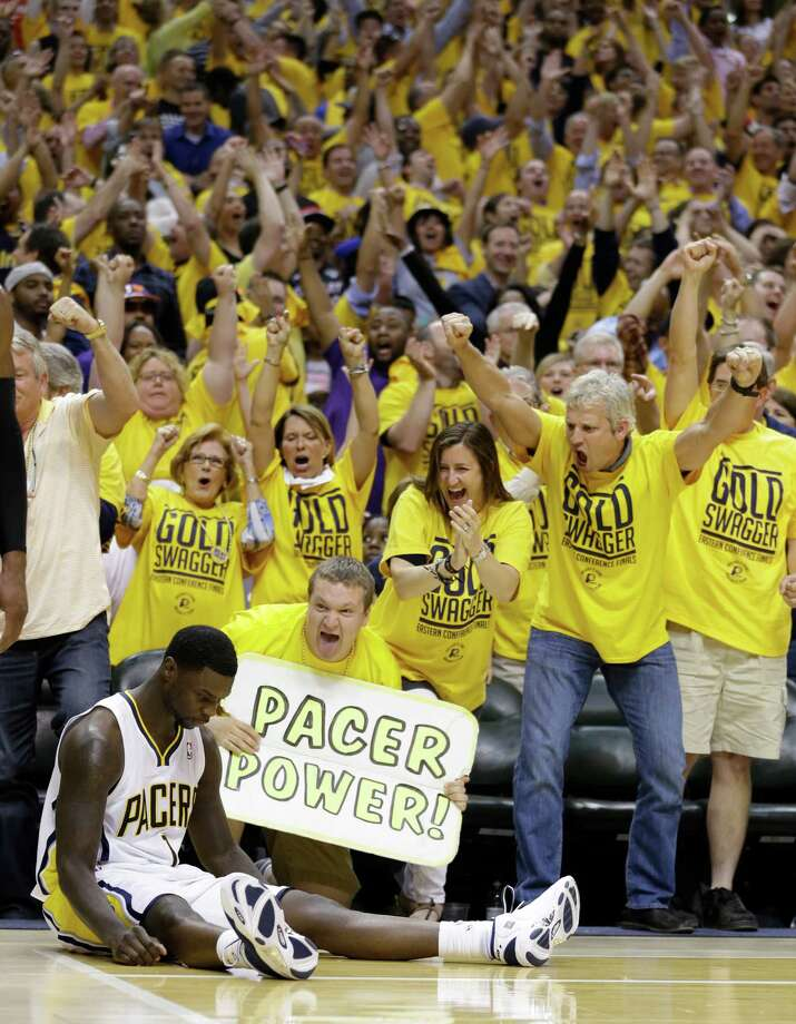 Pacers fans appear more excited than Lance Stephenson about his third-quarter buzzer beater. Photo: Michael Conroy, STF / AP