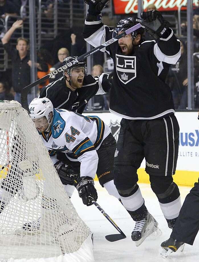Kings' Justin Williams (front) celebrates his first goal next to Sharks defenseman Marc-Edouard Vlasic (44). Photo: Mark J. Terrill, Associated Press