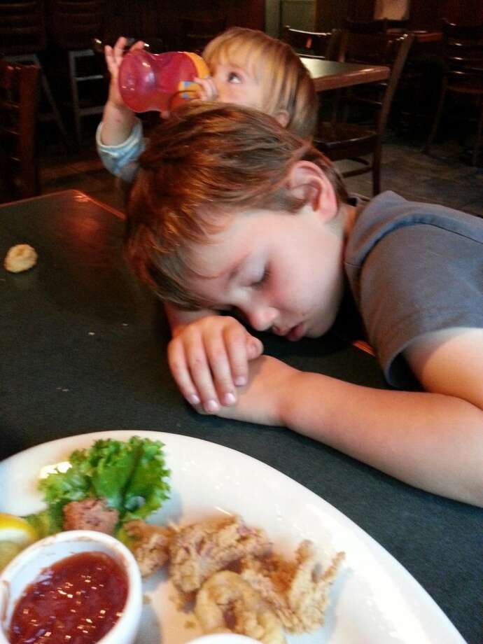 The food at Basso's in Noe Valley was so good it put this little guy to sleep.