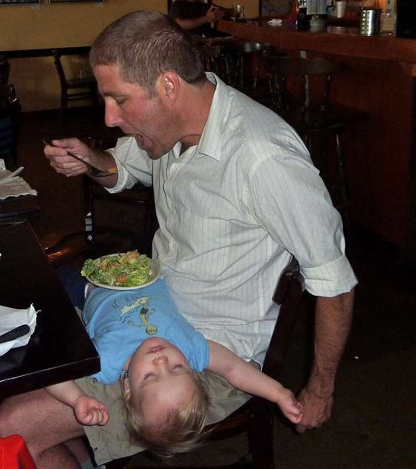 Dad finally gets a chance to eat when the little one falls asleep. Photo: Fsharp