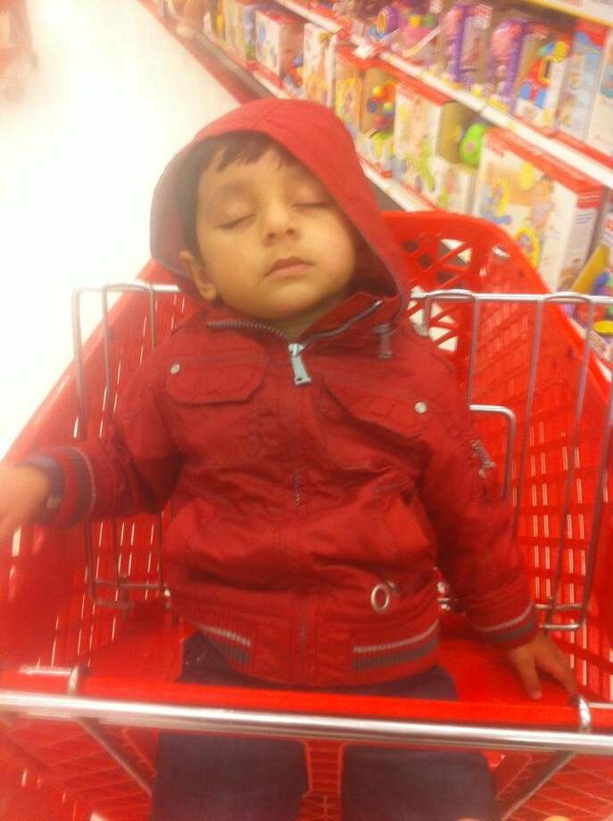 A Target shopping cart is a perfect place to get some rest. Photo: Romi Kaur