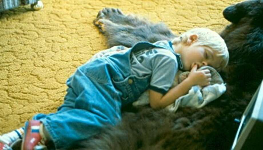 This boy always loved teddy bears so curling up next to his uncle's bearskin rug for a nap was only natural. Photo: Piglet143