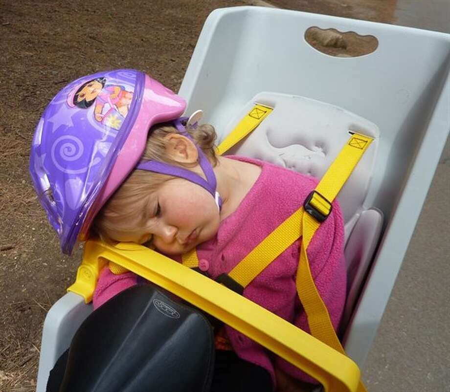 Bike crashed: This little girl fell asleep while riding back to camp from breakfast at the Ahwanee Hotel in Yosemite. Photo: Fsharp