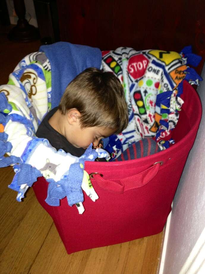 A laundry basket is a comfy spot to nap. Photo: Karey Walker