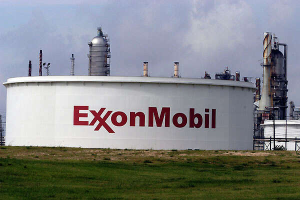 Refineries fill the landscape along the Houston Ship Channel Wednesday, June 9, 2004. Oil prices fell to their lowest levels for more than one month in trading ahead of an expected rise in US crude stocks that helped offset concerns about possible supply disruptions in Iraq and Nigeria, analysts said.  Carlos Javier Sanchez Special to the Chronicle   EXXON/MOBIL.  HOUCHRON CAPTION  (10/07/2004) SECBIZ COLORFRONT:  PLENTY OF CAPACITY: Exxon Mobil operates 45 refineries worldwide, including this one along the Ship Channel in Baytown.