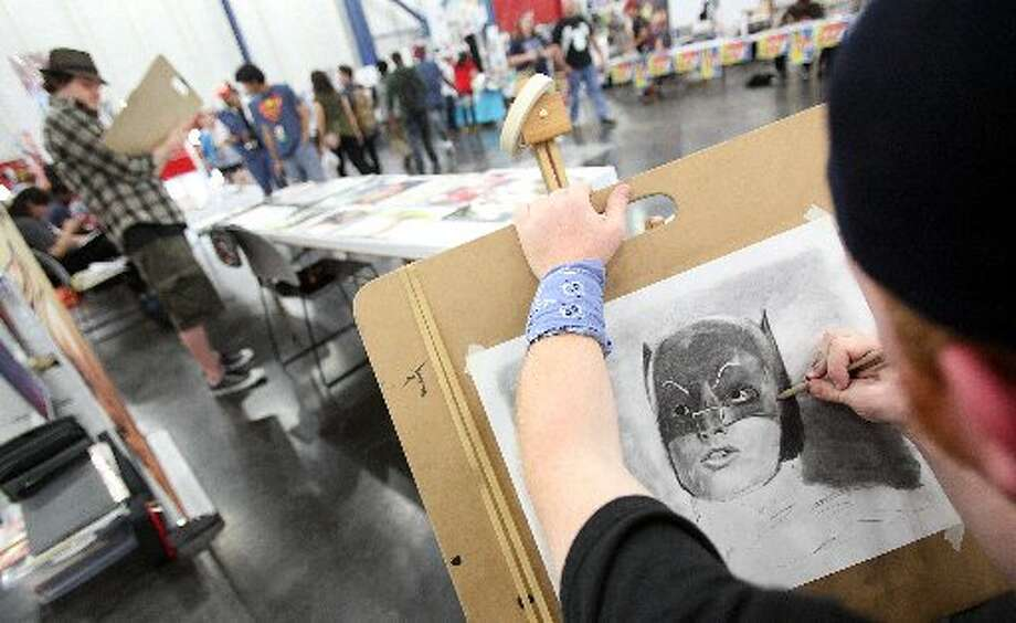 Artist Dale Carroll works on a piece.