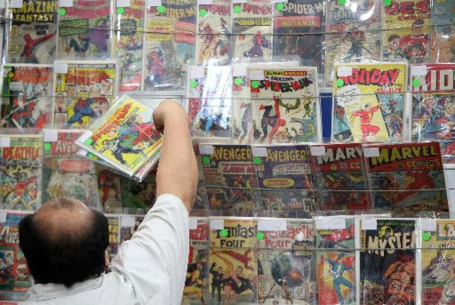 Marvel Comic books and others are for sale.