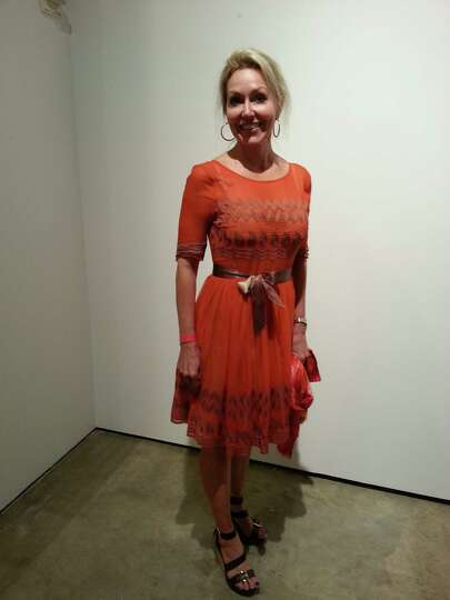 Andi Rodriguez looks summery and festive in one of the season's hottest colors - orange. The
